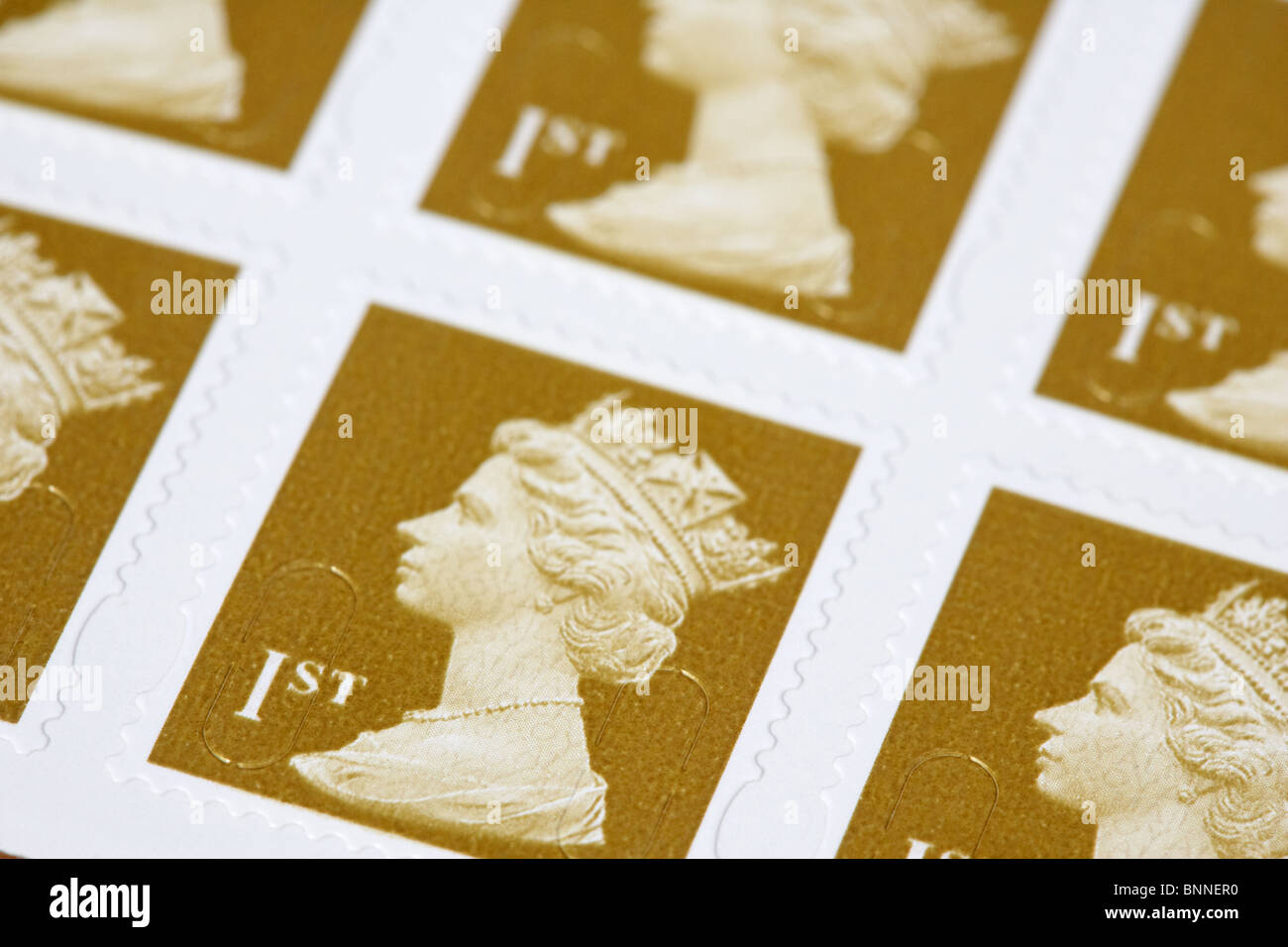 pack of pre-paid first class self adhesive royal mail stamps - Stock Image