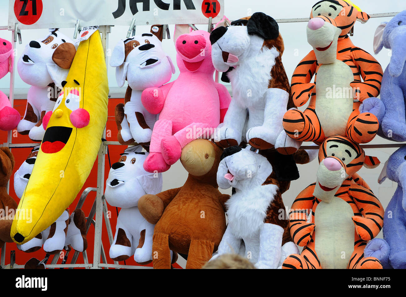 large cuddly toys as prizes on a tombola stall at a fairground, england, uk - Stock Image