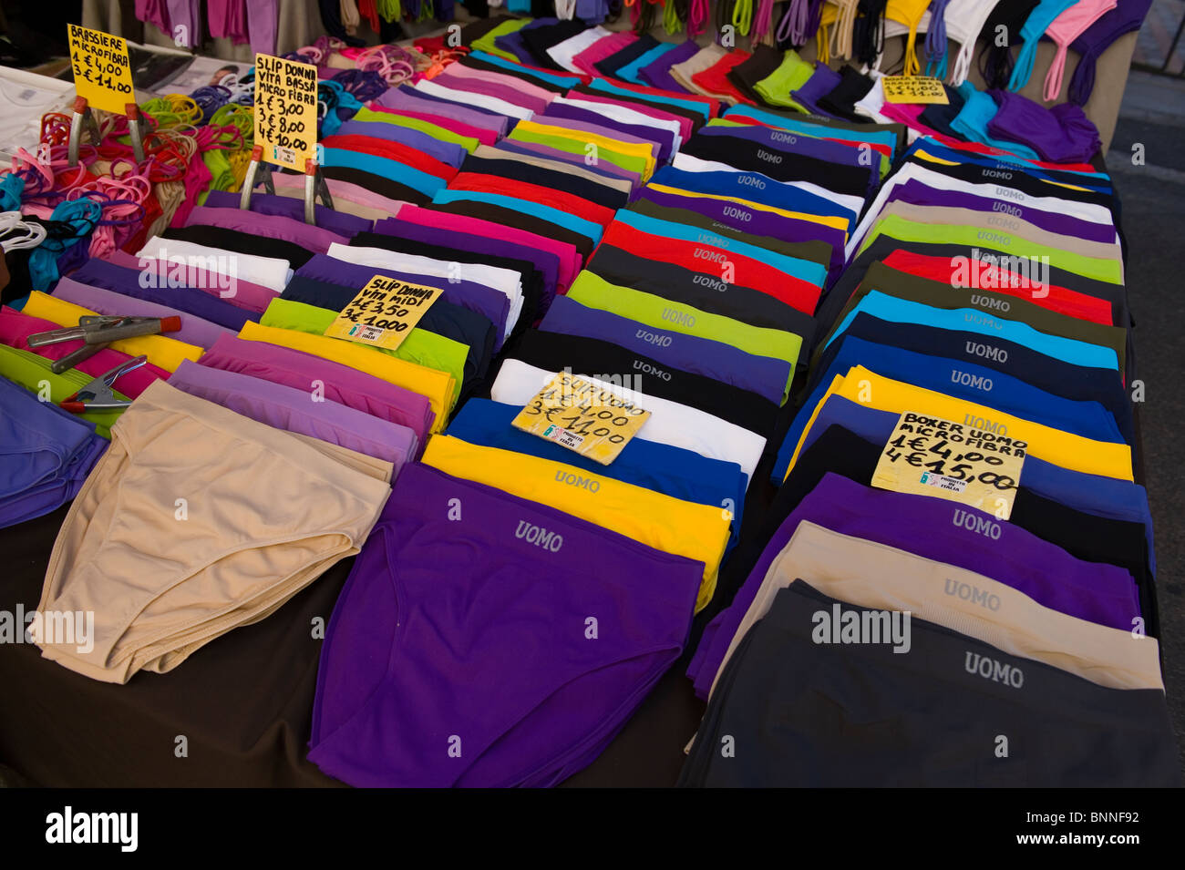 Italy. Tuscany. Colle di val d'Elsa. The weekly market. Pants for sale. - Stock Image