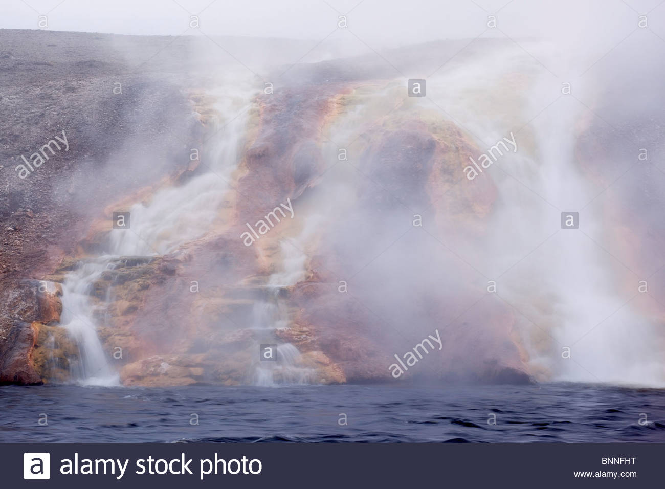 Excelsior Geyser Runoff into Firehole River at Midway Geyser Basin, Yellowstone National Park, Wyoming - Stock Image