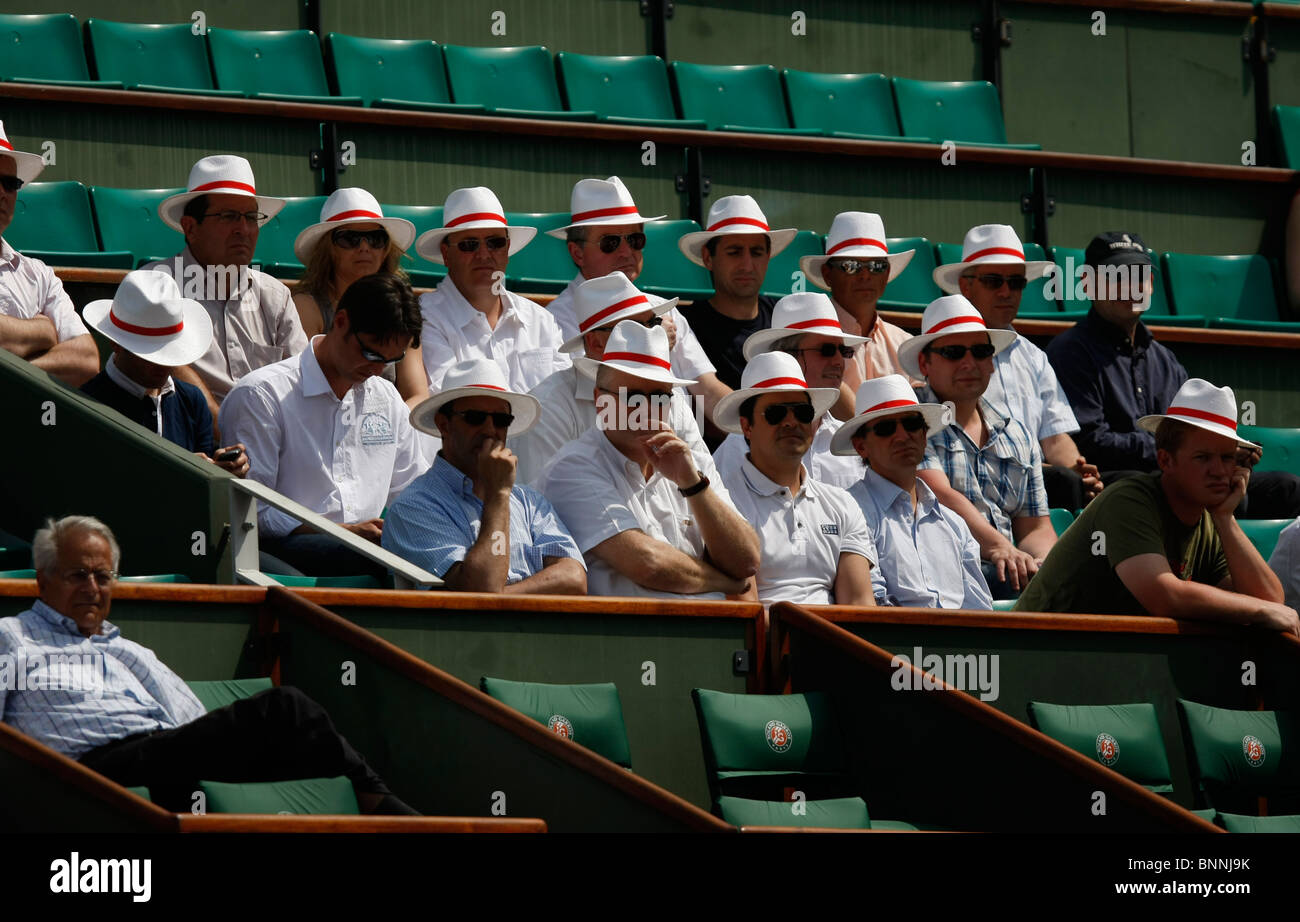 8df1c539b2519 Group of spectators with Panama hats in the VIP Box at the French Open 2010