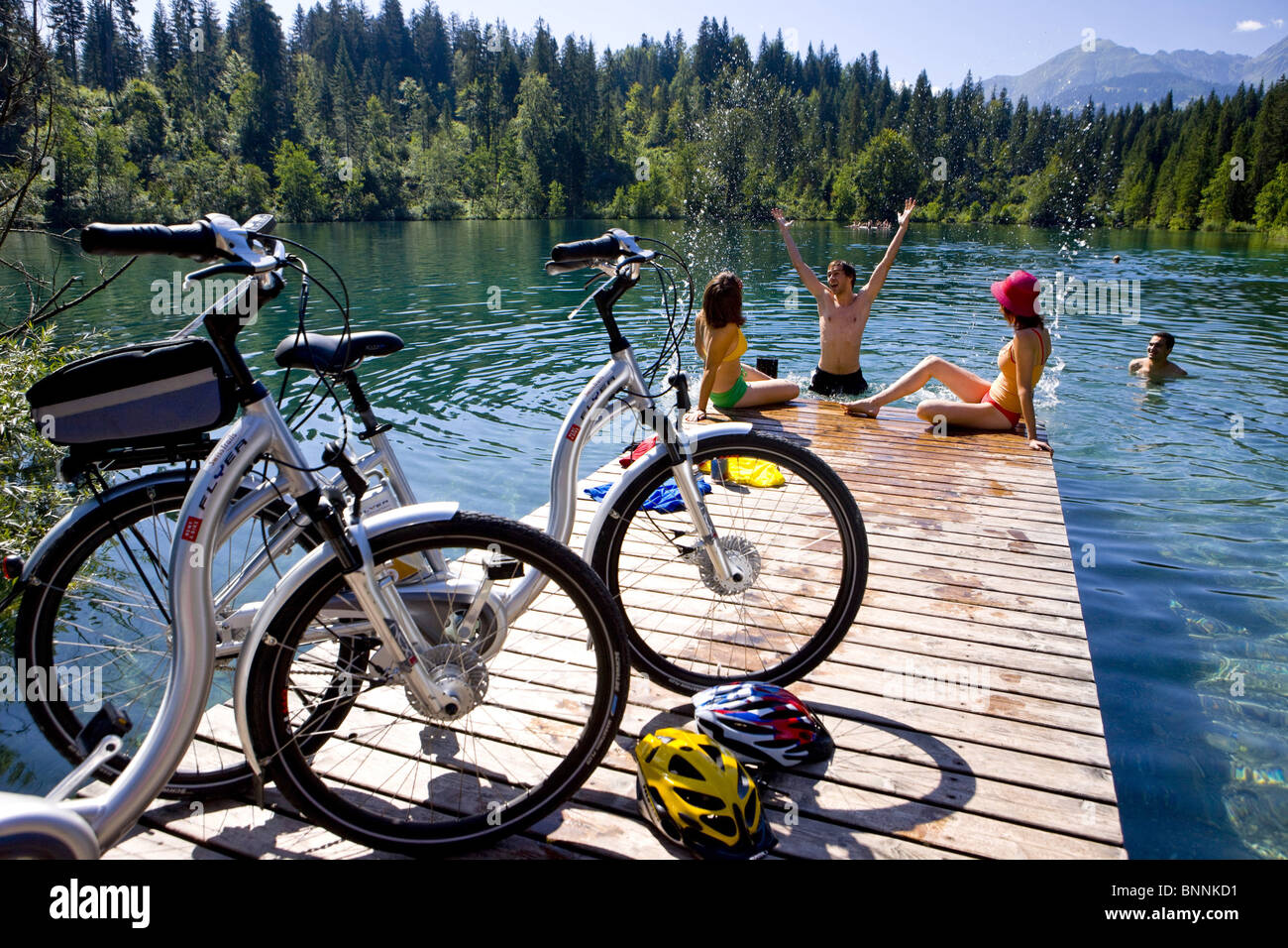 Switzerland swiss bath chat Crestasee summer sport spare time electric bicycles canton Graubünden Grisons group - Stock Image