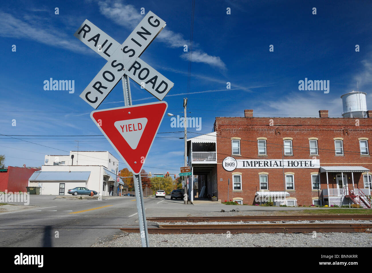 1909 Imperial Hotel Monterey Tennessee USA America United States of America rails Railroad crossing sign - Stock Image