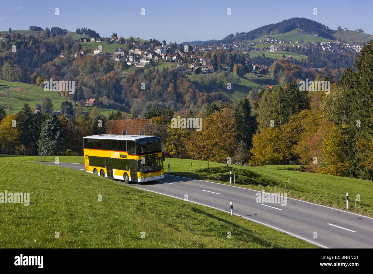 Deceived postal car autumn tree trees scenery canton Appenzell Ausserrhoden Appenzellerland postal car Switzerland - Stock Image