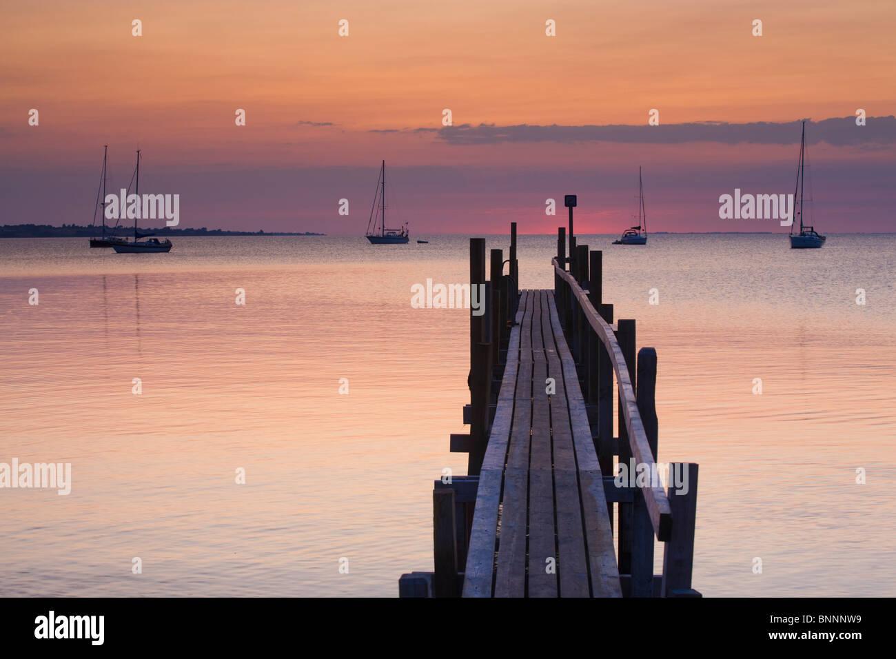 Aeroskobing Denmark island isle Aero beach seashore sea footbridge boats sailing ships sundown evening mood - Stock Image