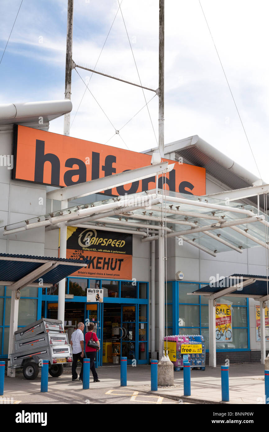 Halfords entrance to store and company logo sign at West Quay, Southampton - Stock Image