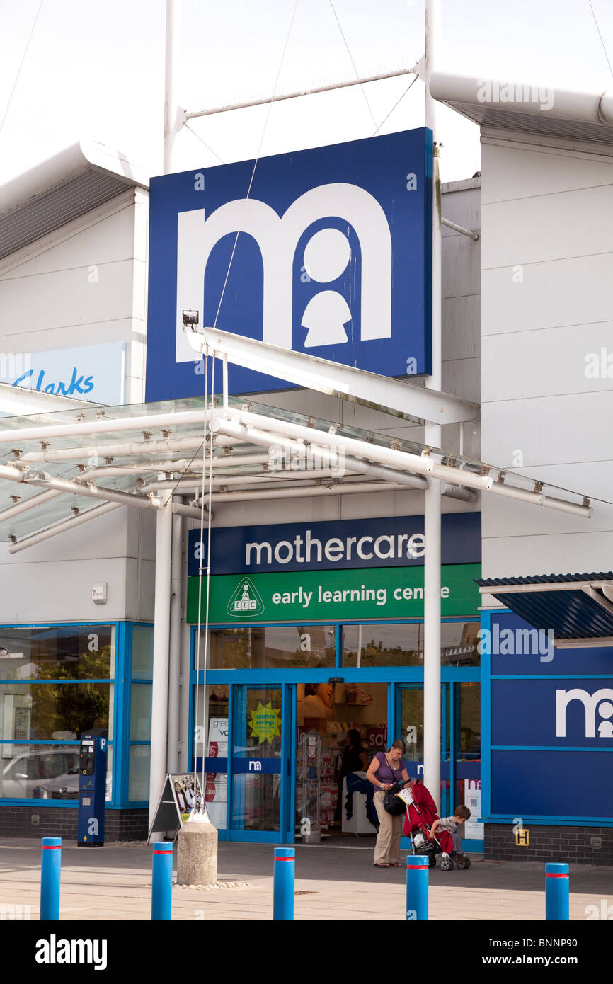 Mothercare entrance to store and company logo sign at West Quay, Southampton - Stock Image