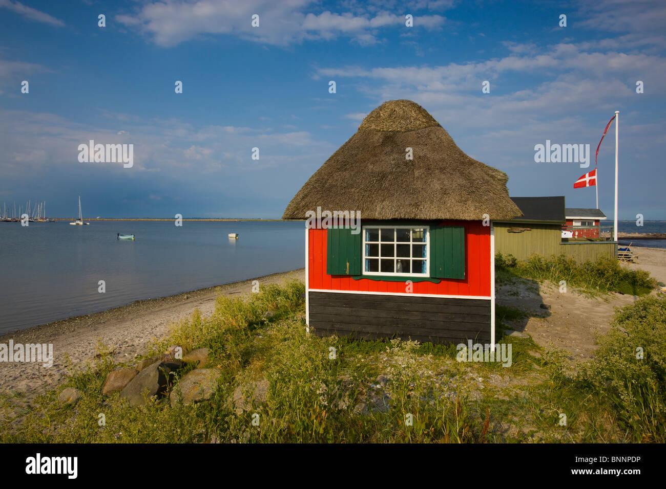 Mars valley Denmark island isle Aero beach seashore beach small house straw roof sea boats Denmark flag - Stock Image