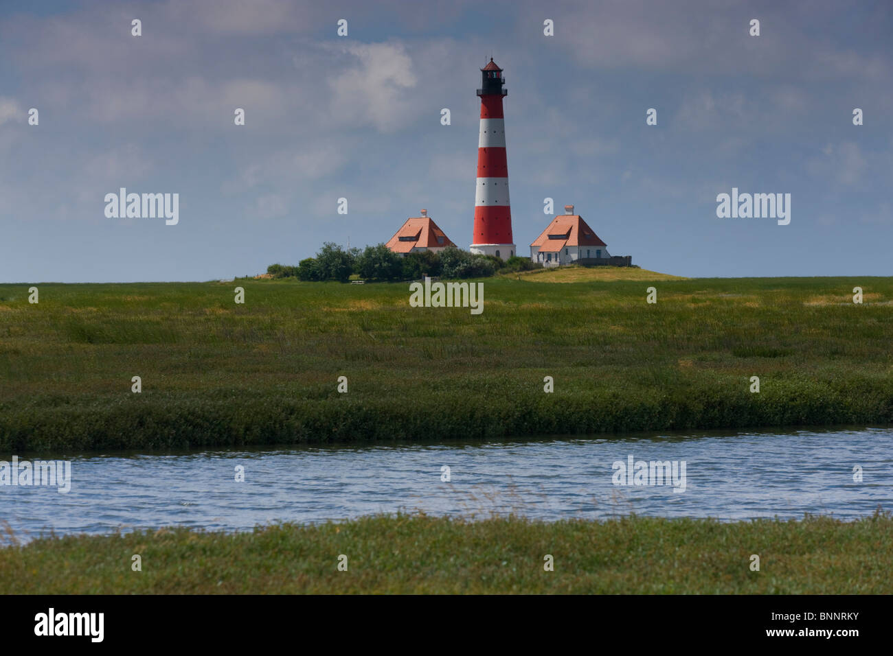 Westerhever Germany Schleswig - Holstein North Sea coast lighthouse brook canal channel pastureland - Stock Image