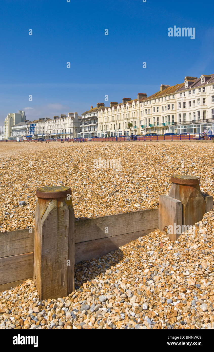 Pebble beach and groynes, hotels on the seafront promenade, Eastbourne, East Sussex, England, GB, UK, EU, Europe - Stock Image