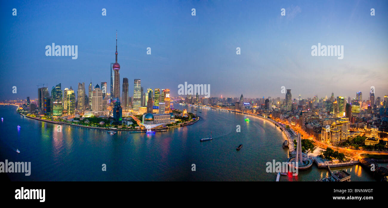 China Shanghai town city blocks of flats high-rise buildings city skyline Huangpu river flow Pudong evening travel - Stock Image