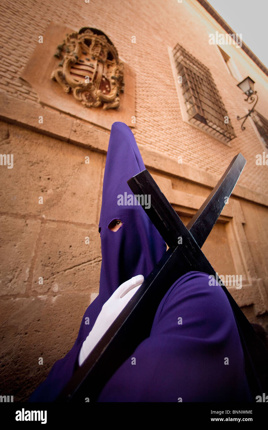 Andalusia Spain Murcia Good Friday religion procession hood cross custom traveling tourism vacation holidays - Stock Image