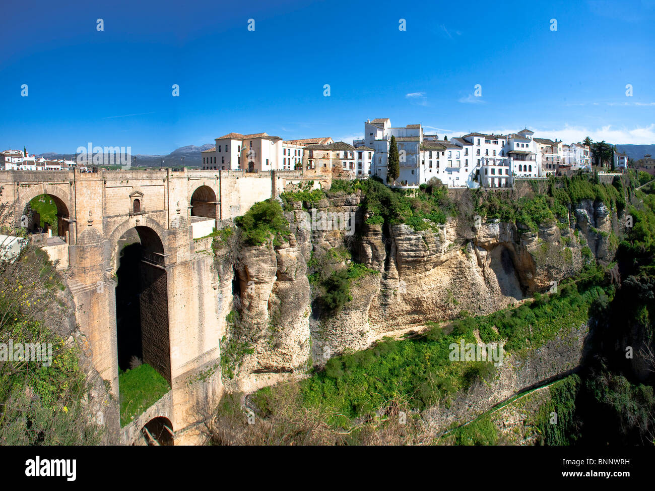 Andalusia Spain Malaga Ronda Middle Ages cliff connection protection bridge curve traveling tourism vacation holidays - Stock Image