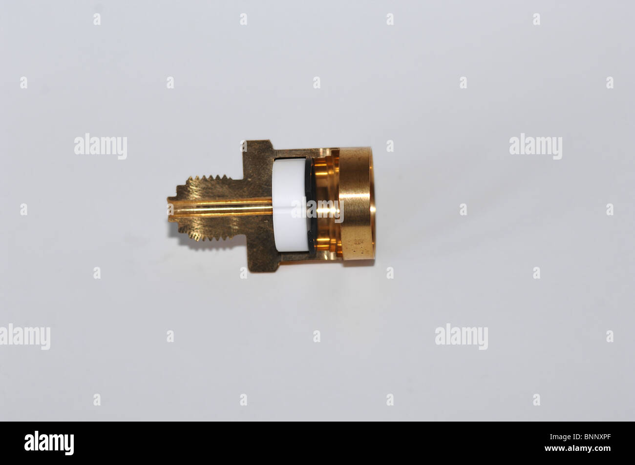 Electronic Pressure Transducer with threaded mount, cut away view showing ceramic transducer element internal to - Stock Image
