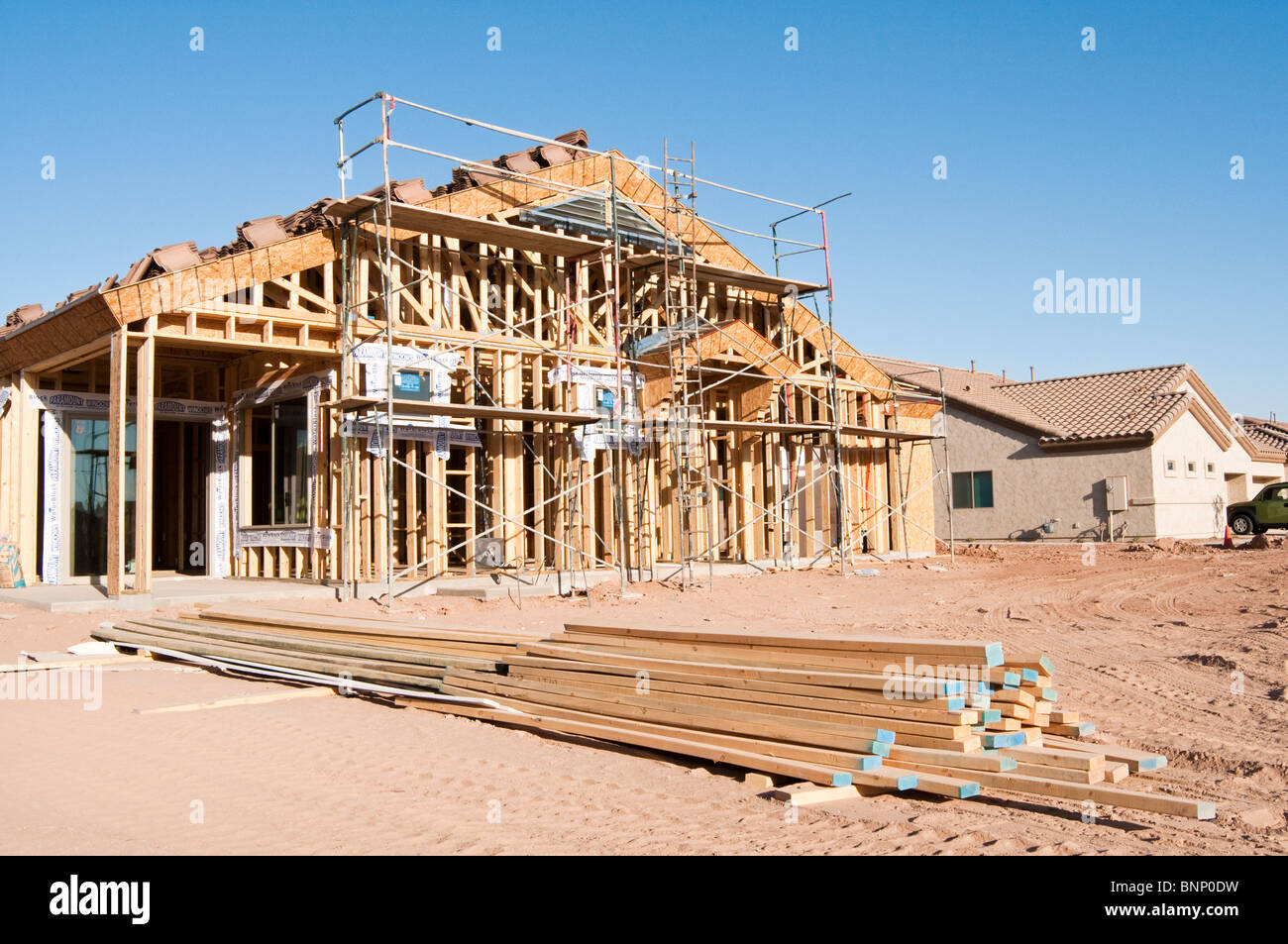 Building materials are stacked on the construction site for Building a house in arizona