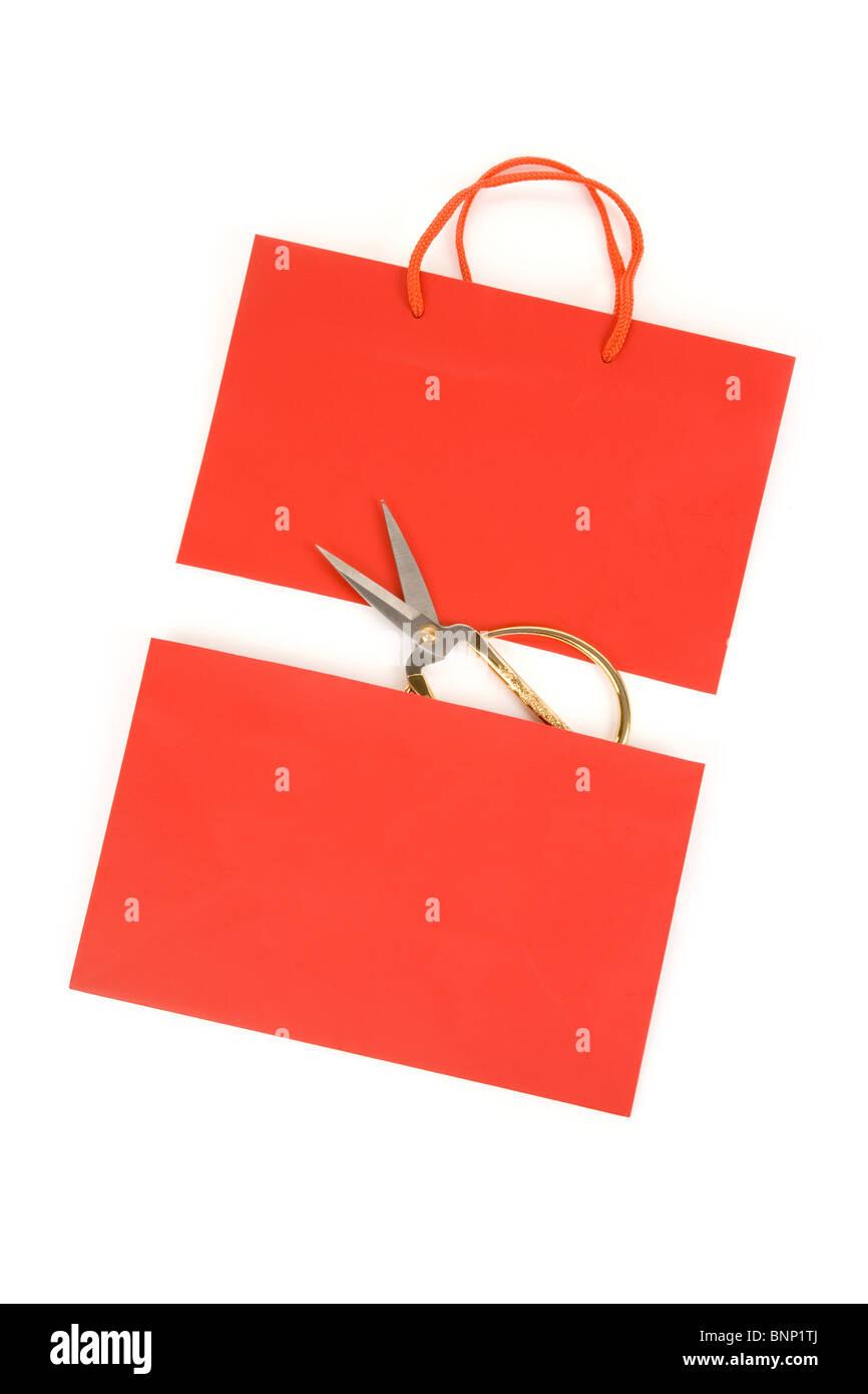 Shopping Bag and scissor, concept of consumer confidence fall - Stock Image