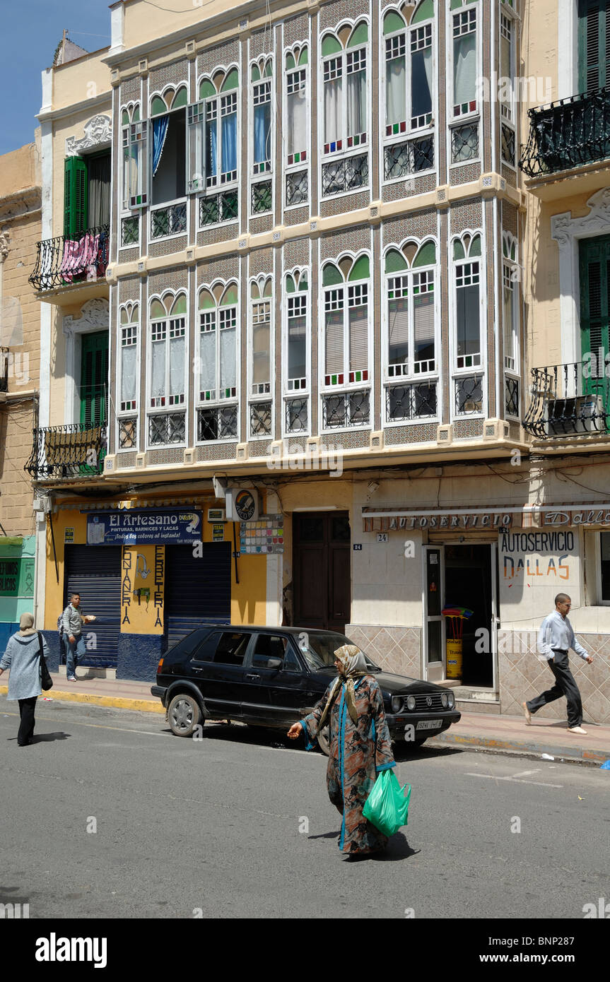 Street Scene with Covered Balcony or Enclosed Glass Veranda or Verandah, Melilla, Spain - Stock Image