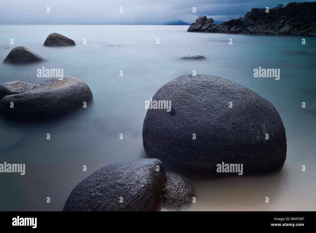 Boulders and still water at Hidden Beach, Lake Tahoe, Nevada, USA - Stock Image