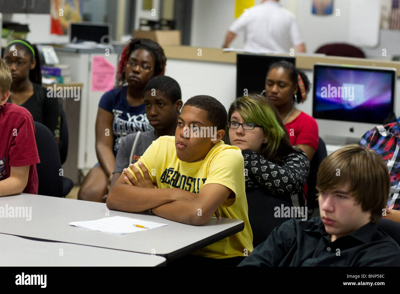 Ethnic, racial mix of students listen to teacher during class at Manor New Tech High School in Manor, Texas - Stock Image
