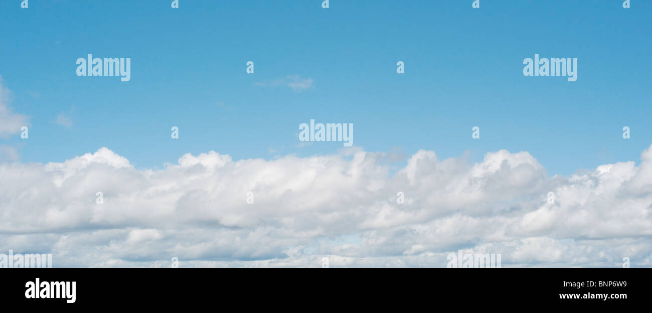 panorama of fluffy white heavenly clouds with copyspace - Stock Image