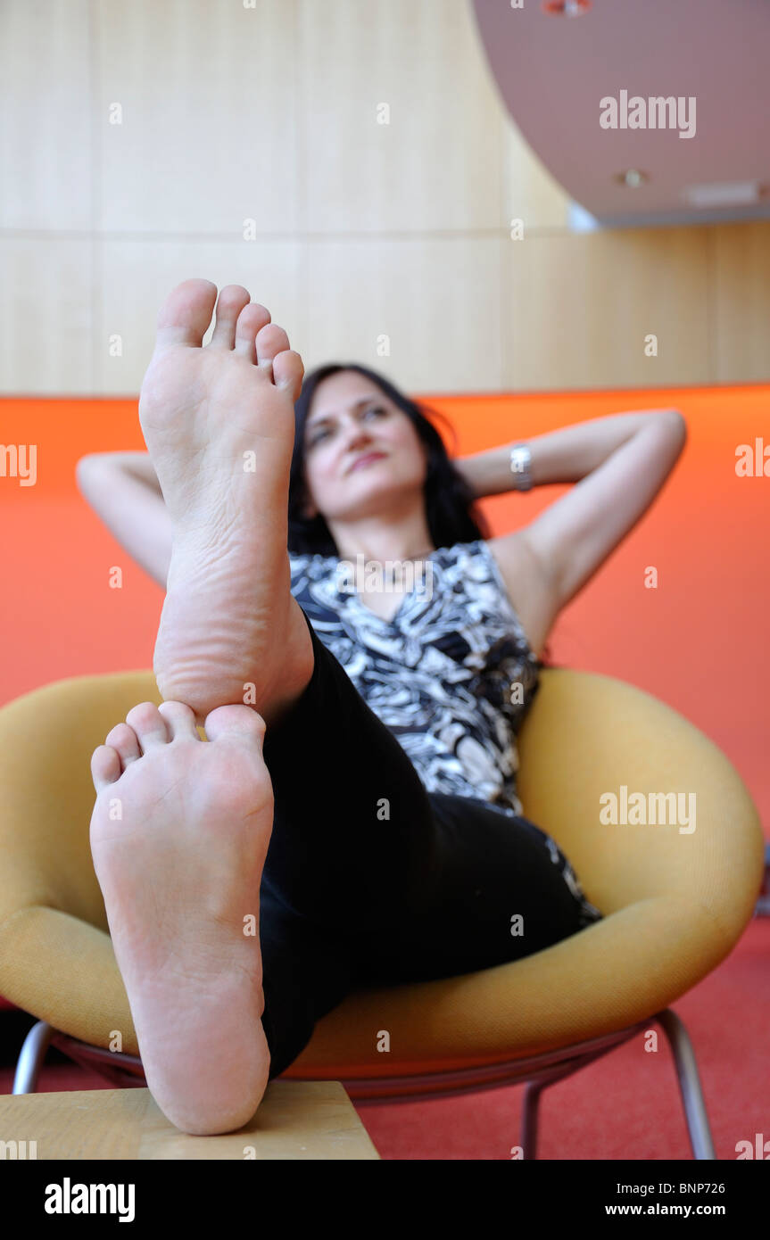 Girl Sitting With Her Feet Up Stock Photo 30606638 Alamy