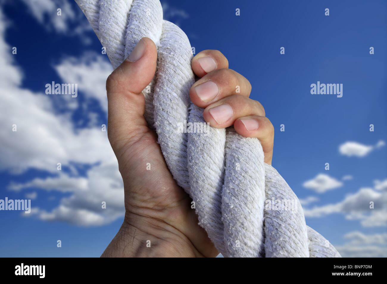 man hand grab grip strong climbing to sky big rope metaphor - Stock Image