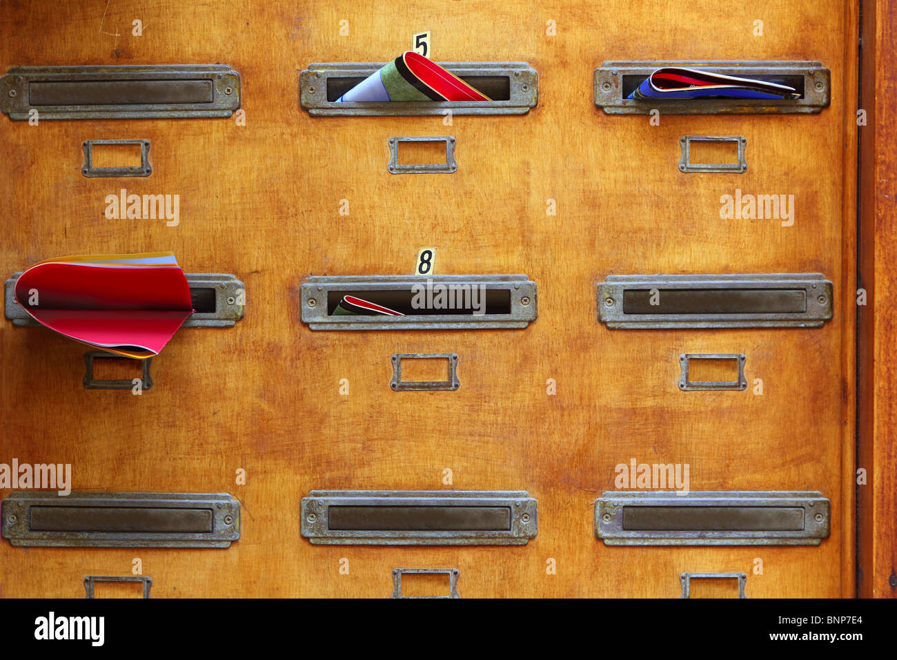 aged mailboxes spain condominium wooden wall rusty brass - Stock Image