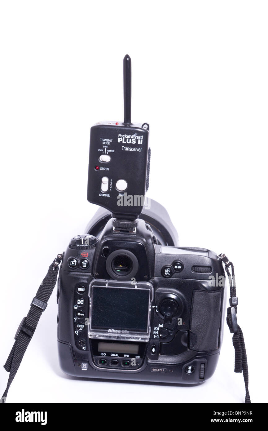 A digital camera DSLR showing a Pocket Wizard radio controlled trigger for firing remote flashguns or cameras - Stock Image
