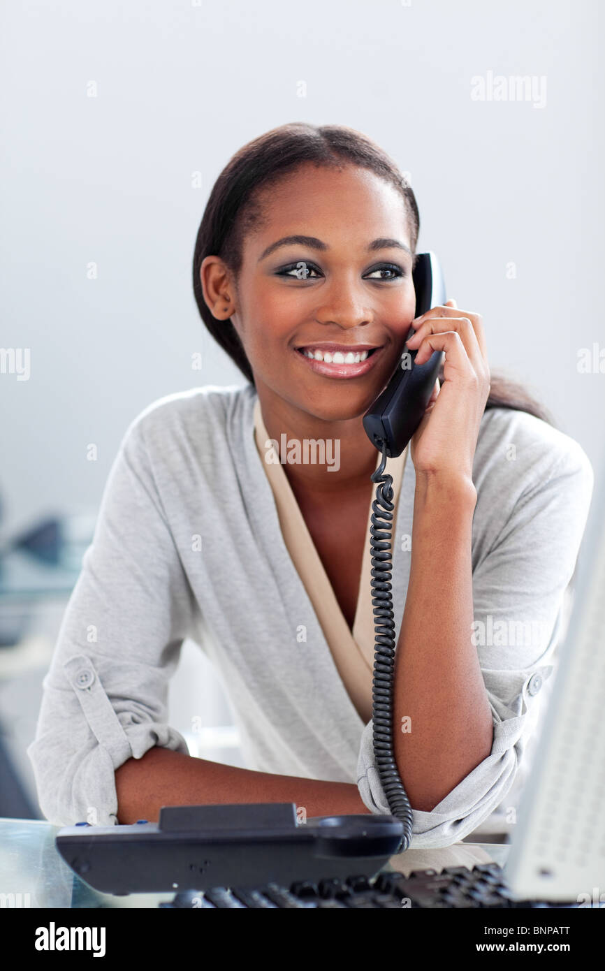 Bright businesswoman talking on a phone Stock Photo