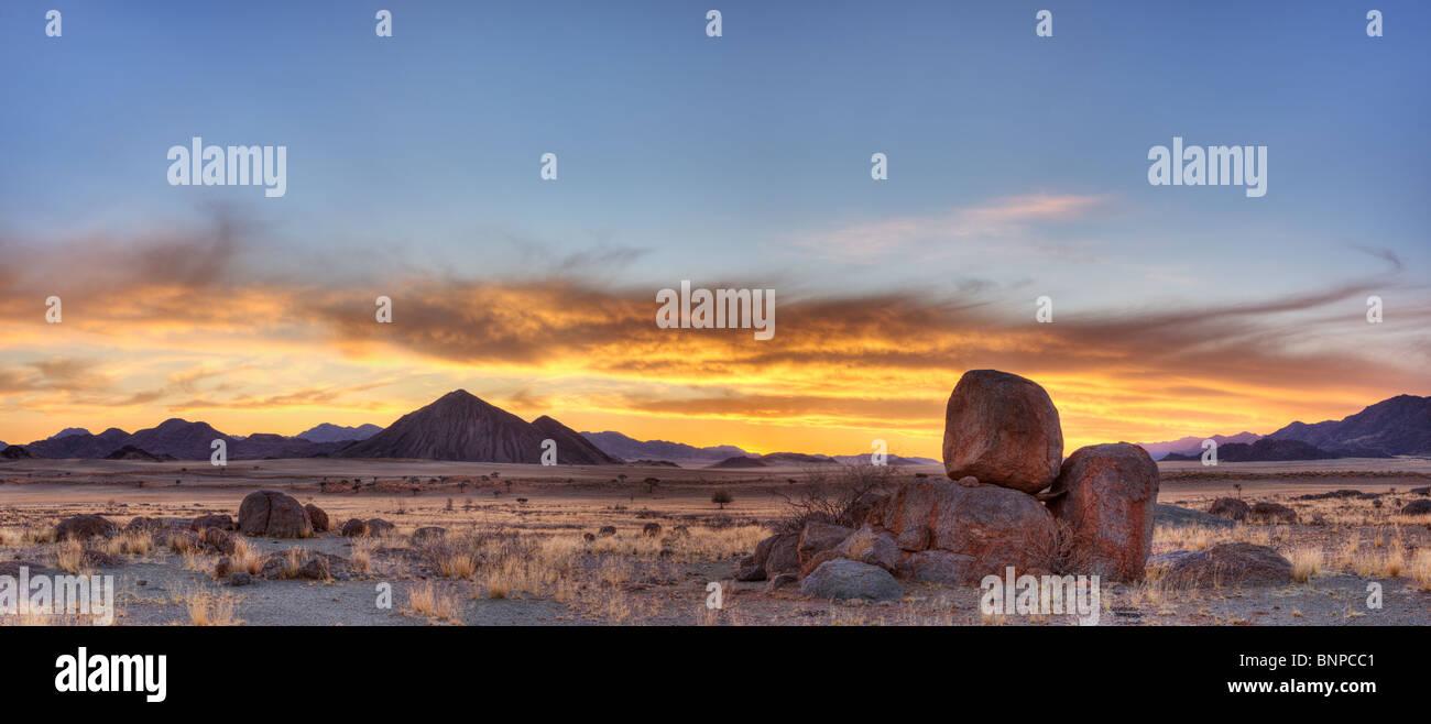 Panoramic of NamibRand Nature Reserve at sunset. Pro Namib Namibia - Stock Image
