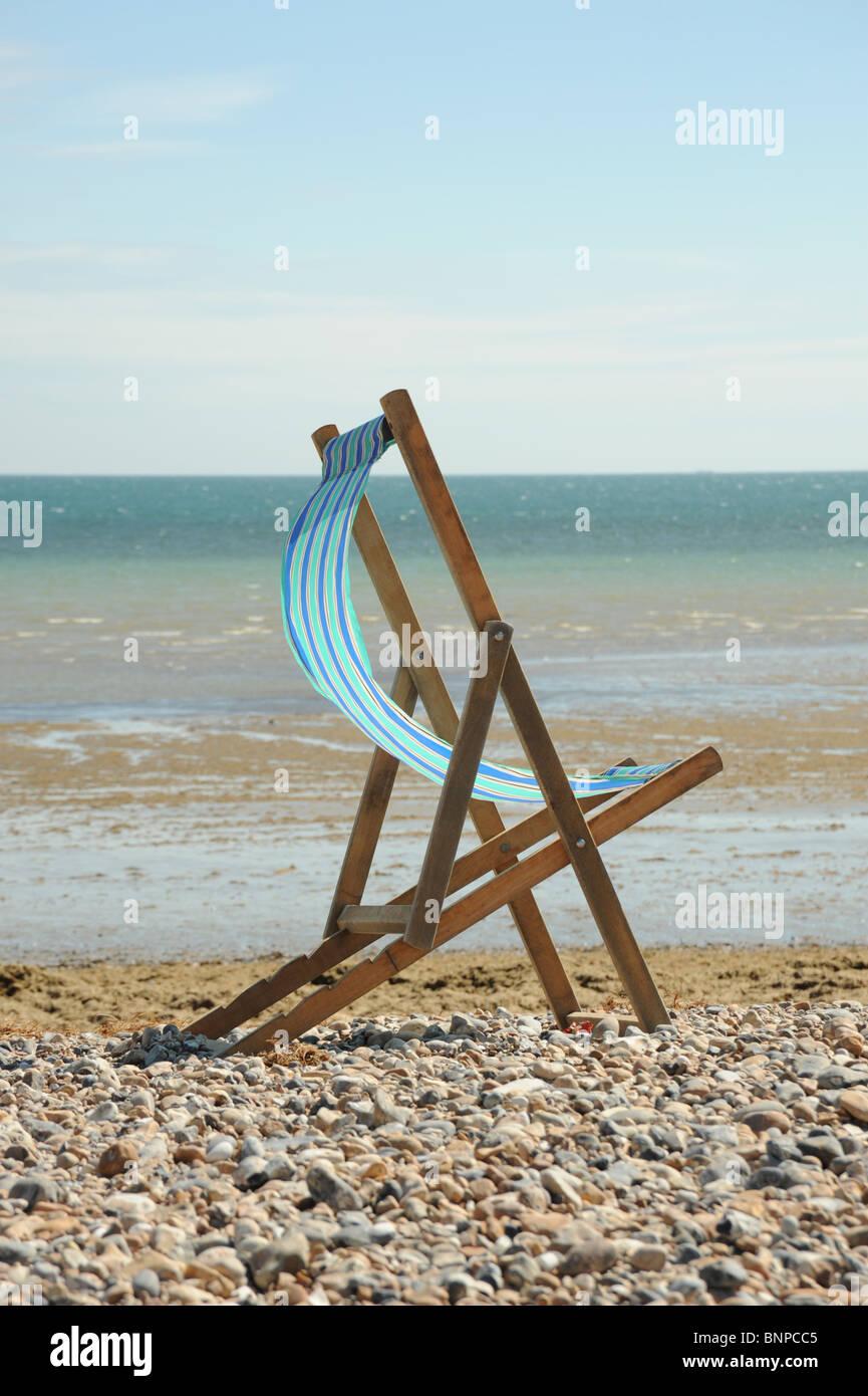 Deck Chair on beach - Stock Image