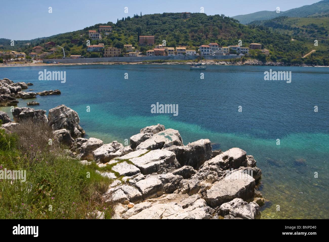 Rocky coastline at Kassiopi on the Greek Mediterranean island of Corfu Greece GR Stock Photo
