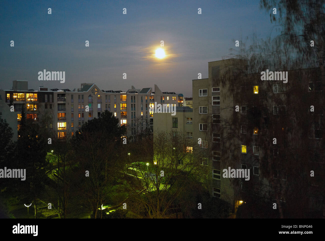 The Moon over an apartment building in Tempelhof, Berlin, Germany - Stock Image