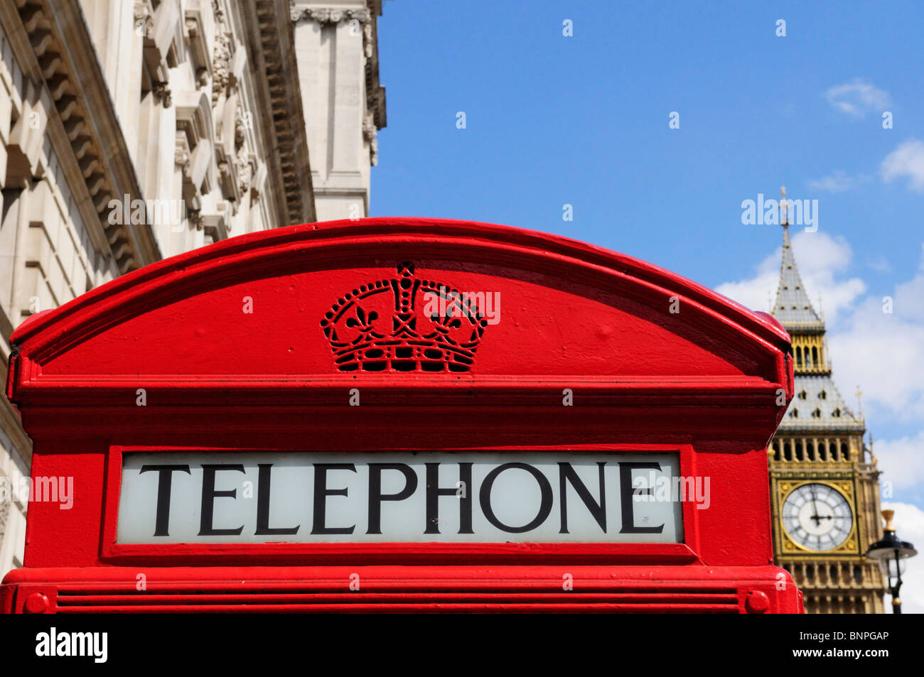 Red Telephone Box with Big Ben, Parliament Square, London, England, UK - Stock Image