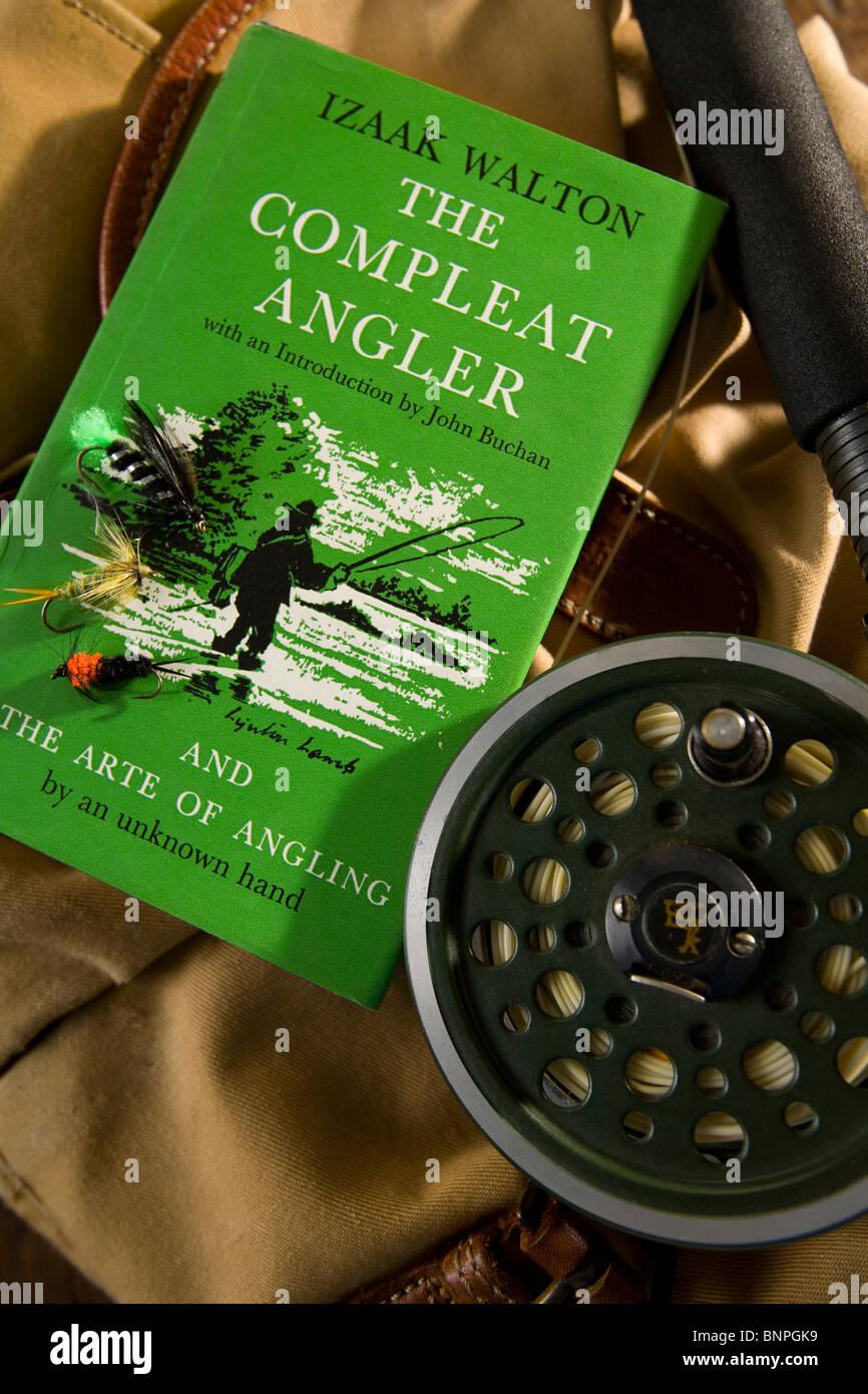 Fly Fishing rod reel bag flies Izaak Walton book The Compleat Angler - Stock Image