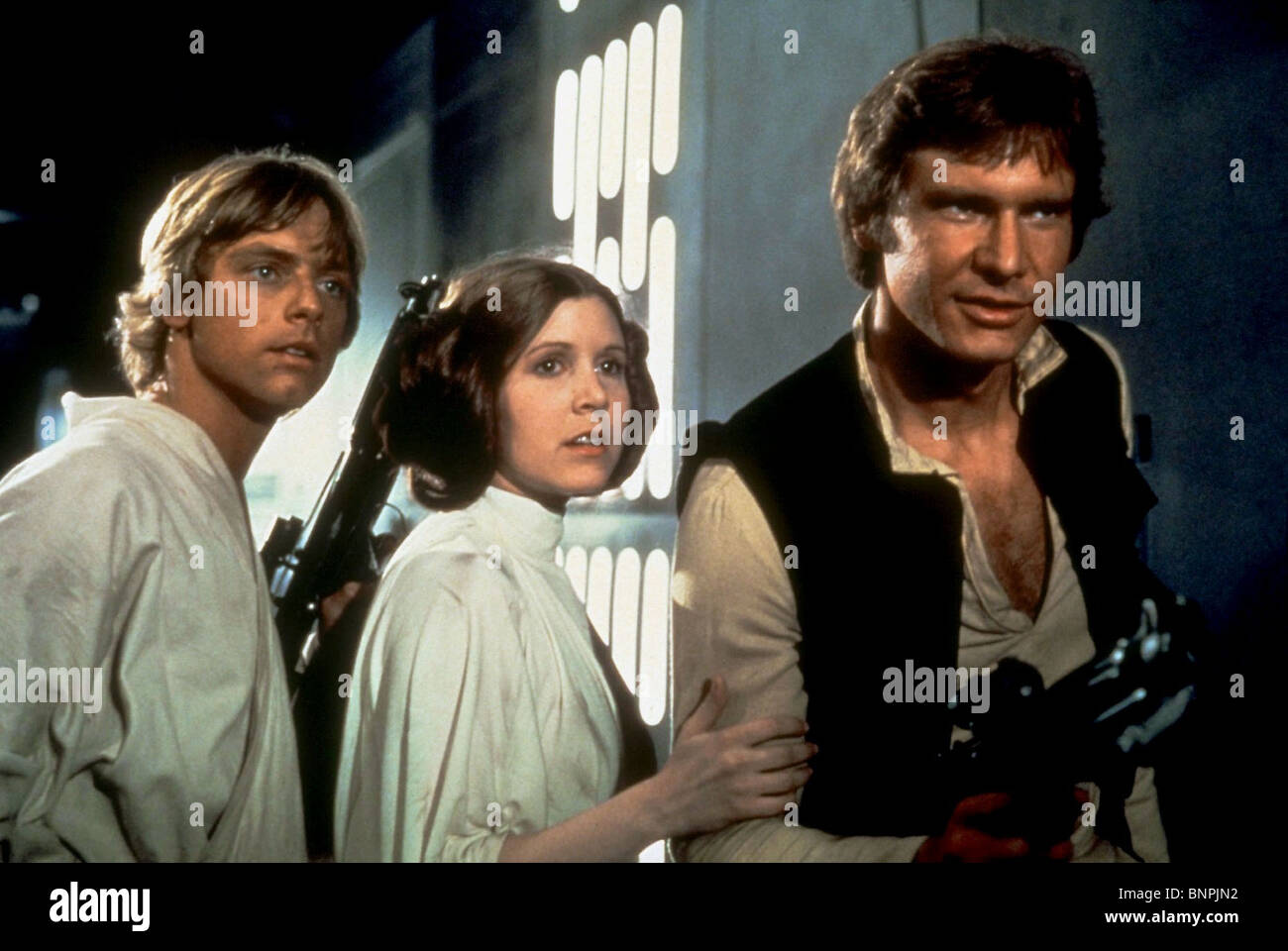 MARK HAMILL CARRIE FISHER HARRISON FORD STAR WARS: EPISODE IV - A NEW HOPE (1977) - Stock Image