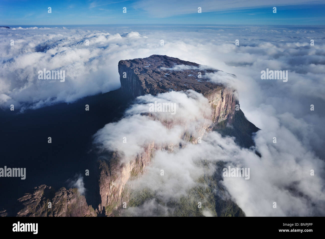 Aerial view Mount Roraima is the highest tepui reaching 2810 meters in elevation. Cloud covered flat top mountains. - Stock Image