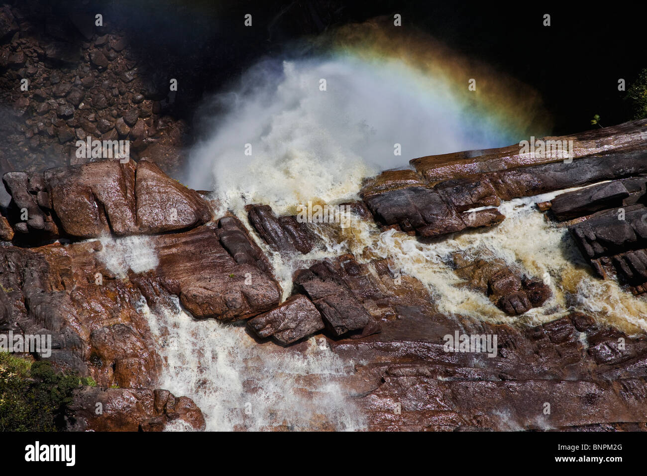 Aerial view of top of waterfall cascading over the side of sandstone cliffs of a tepui Venezuela - Stock Image