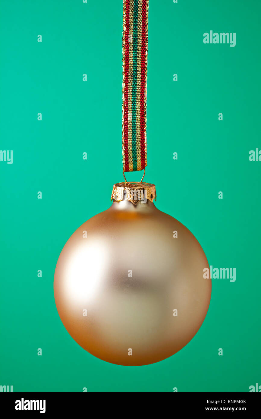 Gold Christmas ornament with ribbon - Stock Image