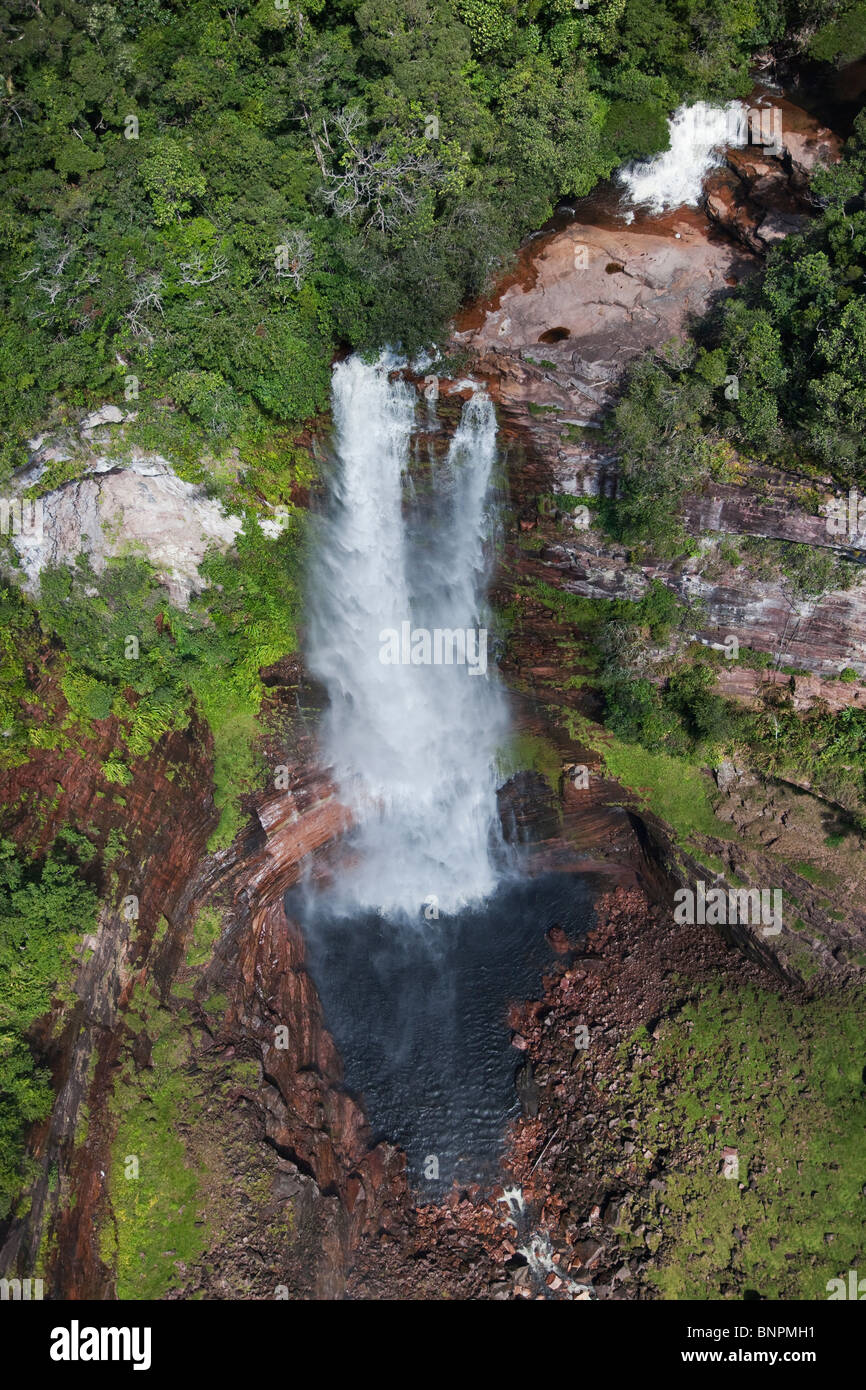 Aerial view of waterfall cascading over the side of sandstone cliffs of a tepui Venezuela - Stock Image