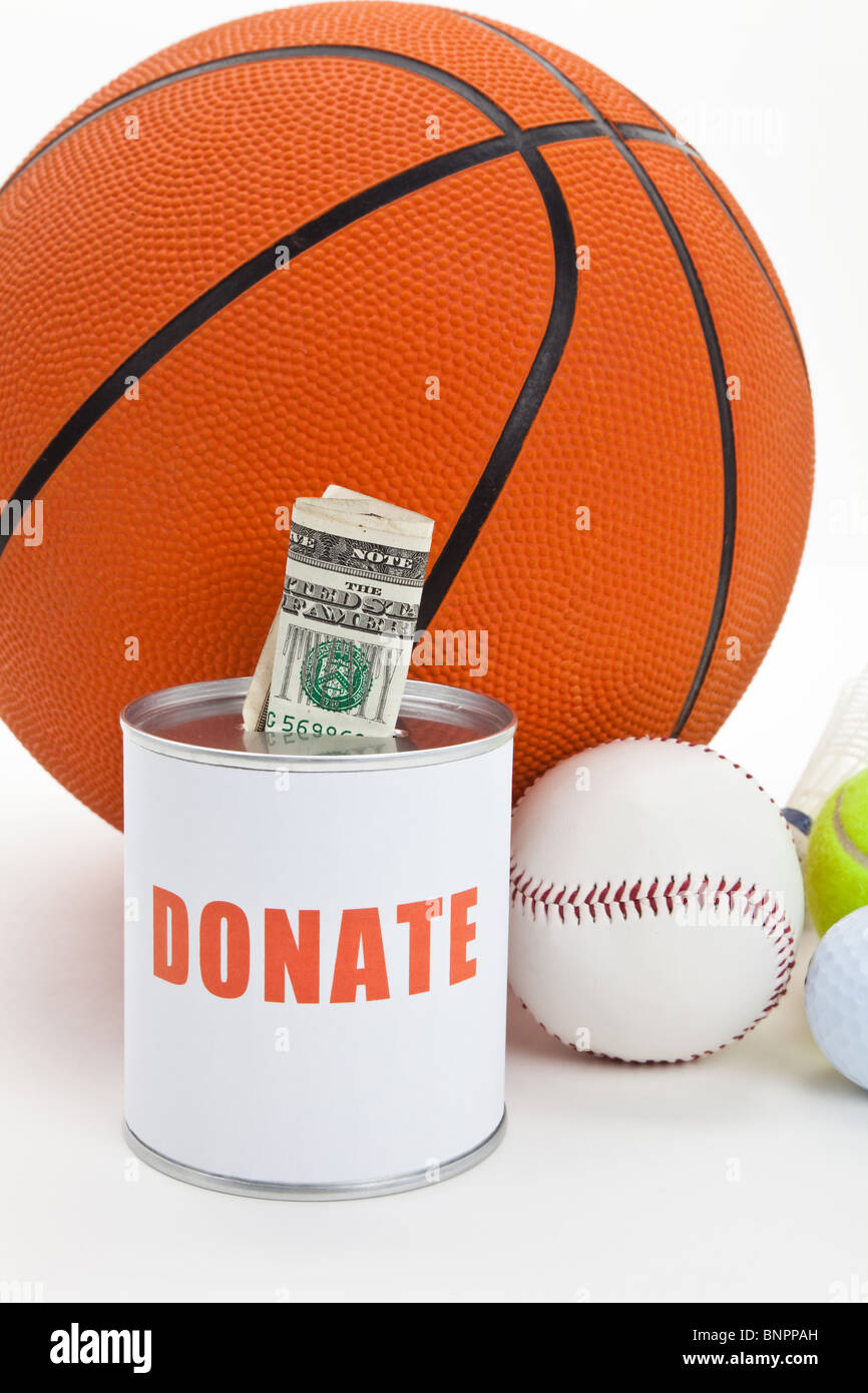 Donation Box and balls, concept of sport funds - Stock Image