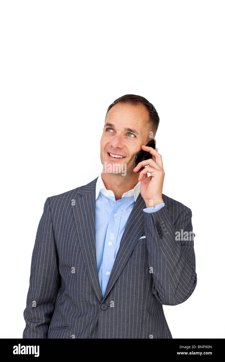 Charming businessman on phone looking upward - Stock Image