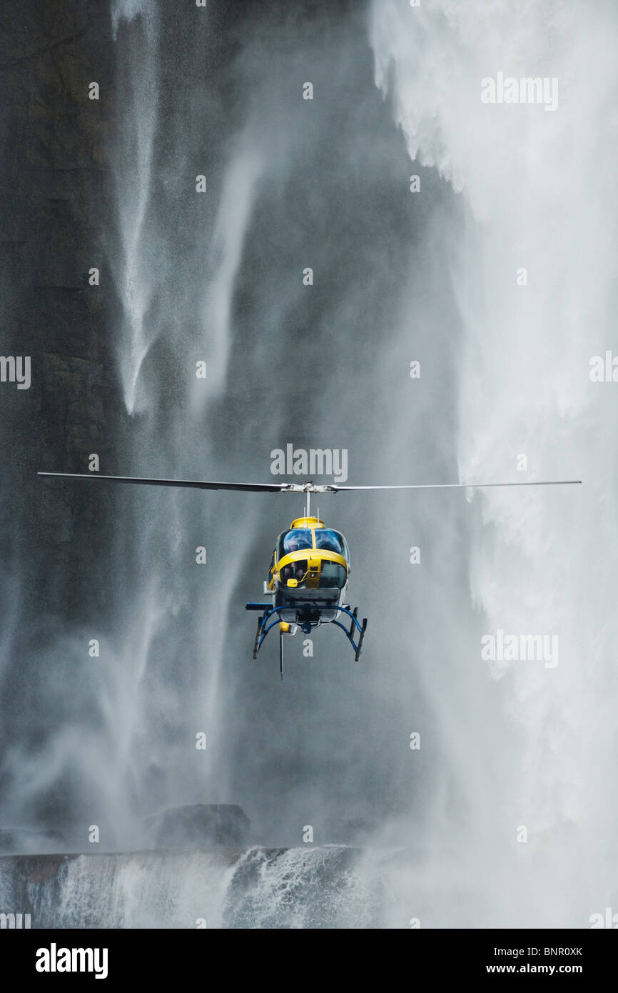 Helicopter flying in front of Aponwao waterfall Venezuela - Stock Image