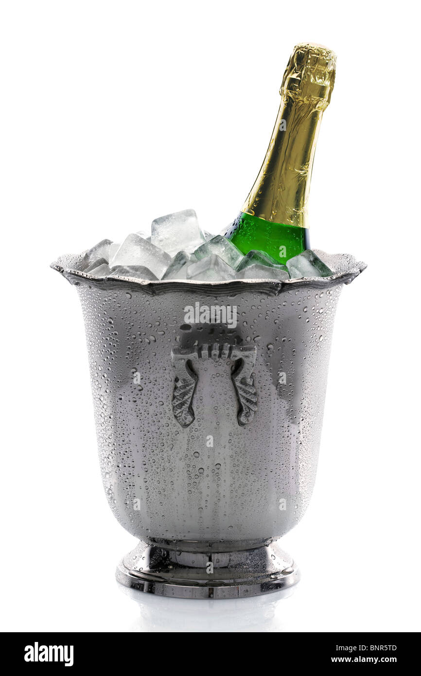 Cold bottle of champagne in ice-bucket filled with ice (isolated on white background) - Stock Image