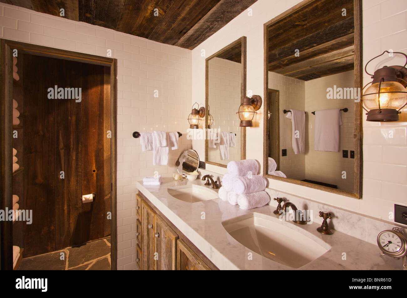Luxurious Rustic Bathroom with Mining Lamps in Spa Setting Stock ...