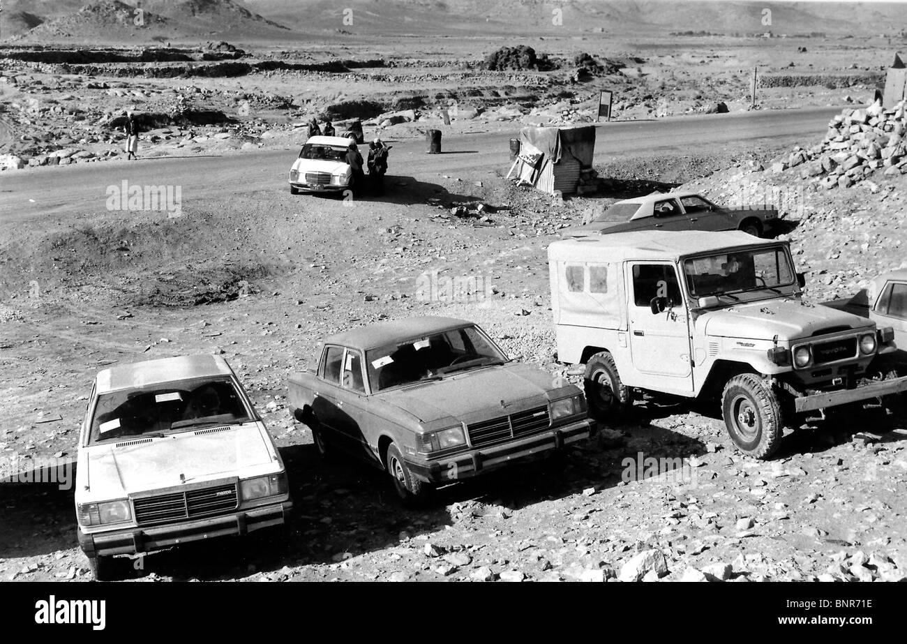 Yemeni roadblock outside Sana`a in 1981 with smuggled cars from Jeddah, Saudi Arabia.  . - Stock Image