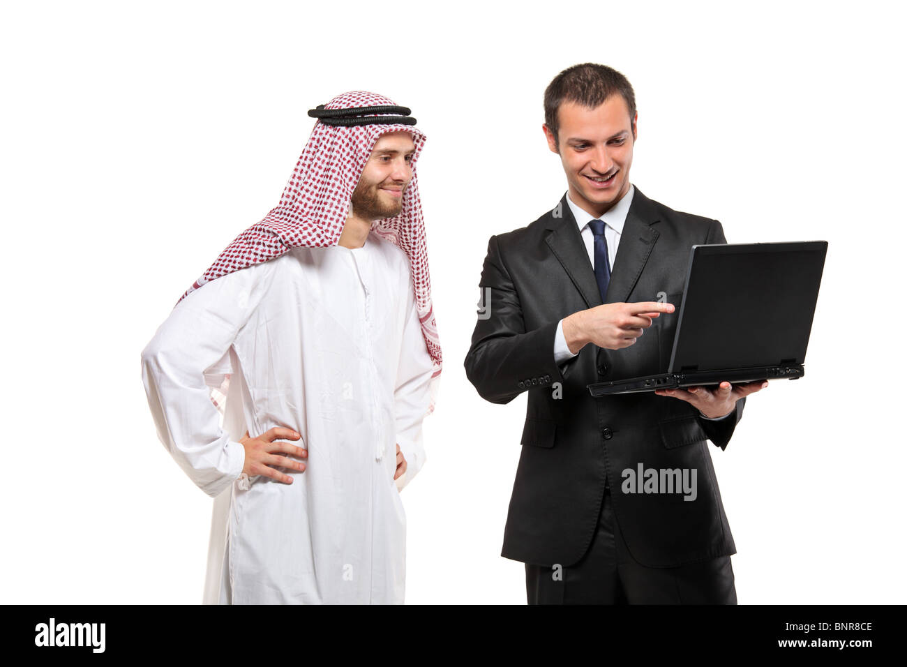 Happy businessmen with a laptop computer - Stock Image