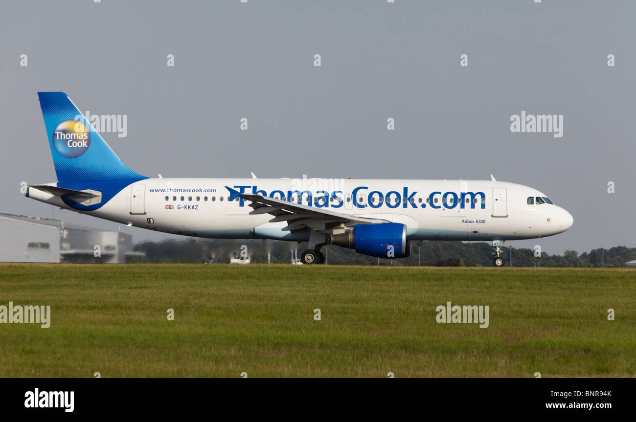 Thomas Cook Airlines Airbus A320-214 taking off at Stansted Airport, Essex, England, United Kingdom - Stock Image