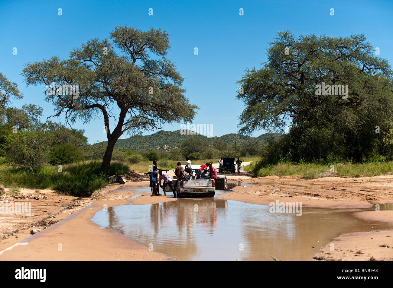 Pickup car stuck crossing a sandy river Grootberg in northern Namibia - Stock Image