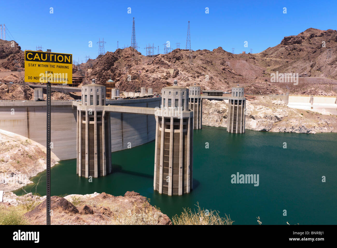 USA Nevada/Arizona border - Hoover Dam on the Colorado River, Lake Mead. Warning sign. Drought low water June 2010. Stock Photo